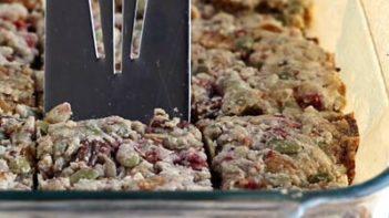cutting into granola bars with a spatula
