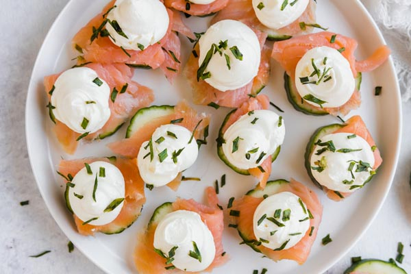 a plate with salmon cream cheese bites on it