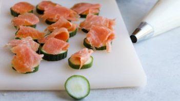 smoked salmon folded on top of slice cucumbers