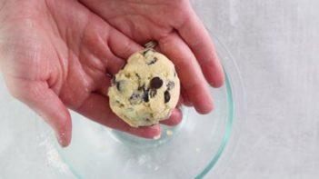 cookie dough ball in hands