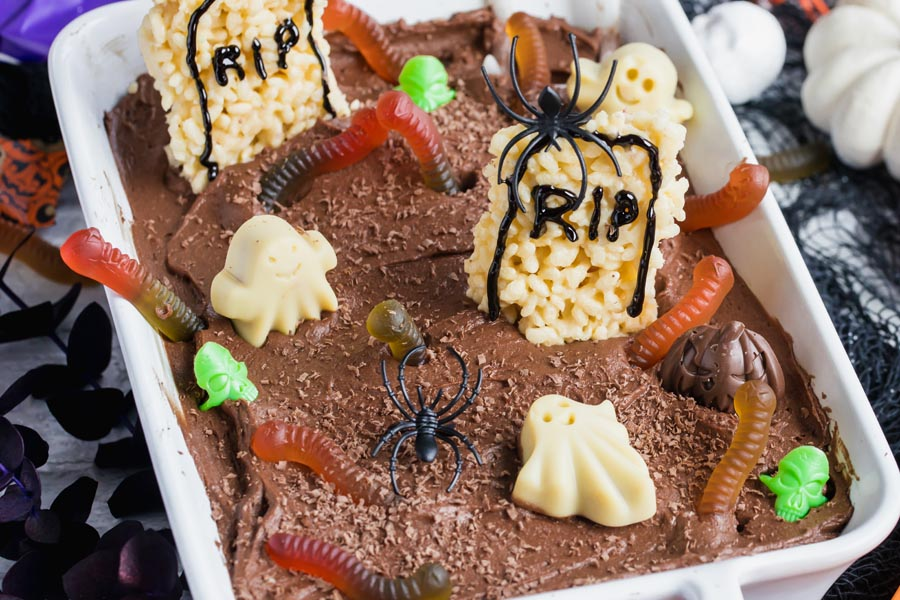 a chocolate cake decorated like a graveyard with gummies and chocolates