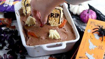 decorating a graveyard scene on a cake