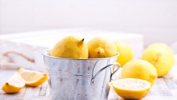 lemons in a silver bucket